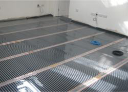 Electric under floor heating foils being fitted